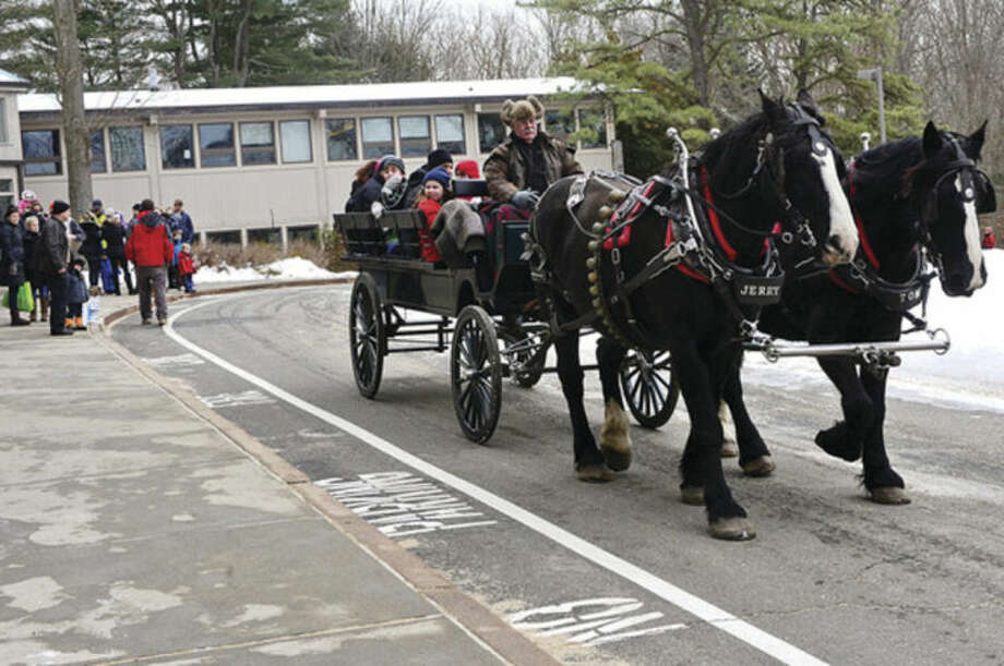Hour photo / Erik Trautmann The Earthplace 2014 Winterfest in Westport offered horse drawn carriage rides Saturday.