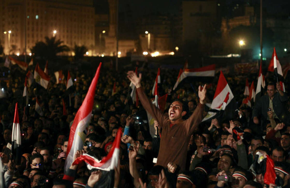 FILE- In this Feb. 11, 2011 file photo, Egyptians celebrate the news of the resignation of President Hosni Mubarak, who handed control of the country to the military, at night in Tahrir Square in downtown Cairo, Egypt. As Egyptians mark the third anniversary of their revolution against autocrat Hosni Mubarak in the name of democracy, there has been a powerful sign of the country?'s stunning reversals since: letters of despair by some of the prominent activists who helped lead the uprising, leaked from the prisons where they are now jailed. The letters show a daunted and broken spirit, no longer speaking of imminent democracy, but of injustices and a failed struggle. (AP Photo/Ben Curtis)
