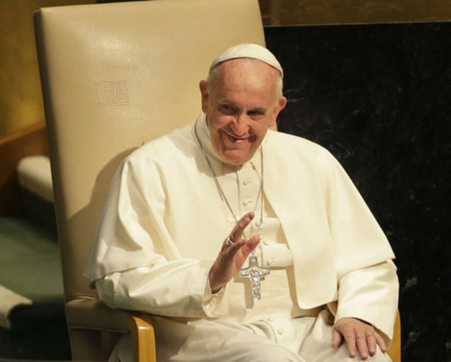 Pope Francis waves as he prepares to address the 70th session of the United Nations General Assembly, Friday, Sept. 25, 2015 at United Nations headquarters. (AP Photo/Seth Wenig)