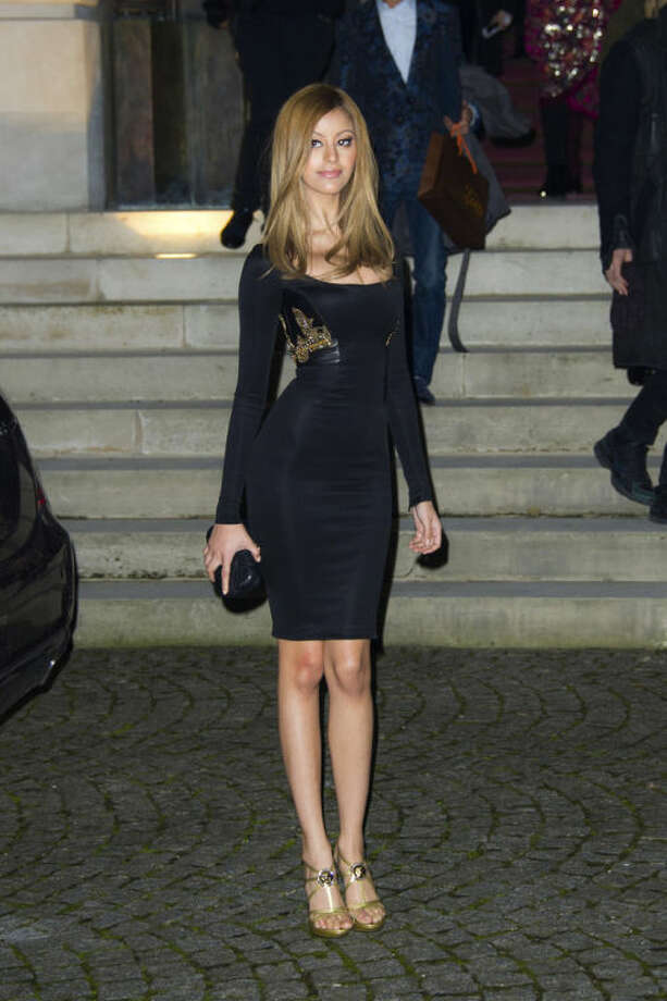 Fashion designer Zahia Behar leaves after attending attend the Atelier Versace Spring-Summer 2014 Haute Couture fashion collection, presented Sunday, Jan. 19, 2014 in Paris. (AP Photo/Zacharie Scheurer)