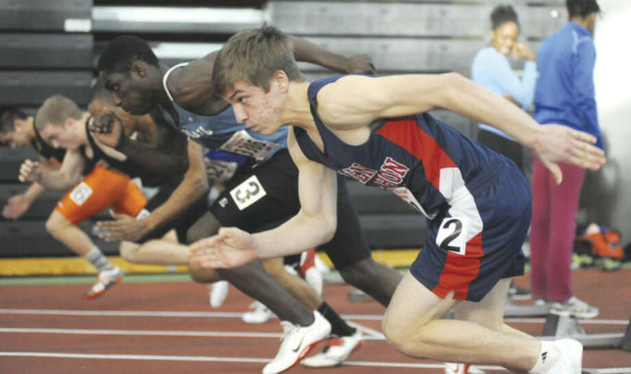 Hour photo/John NashNiko Petridis of Brien McMahon, foreground, bursts out of the blocks during the 55-meter heat race at Monday's State Open Track Championship meet in New Haven.