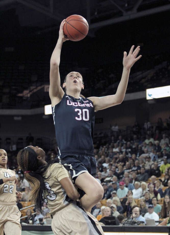 University of Connecticut forward Breanna Stewart (30) shoots over Central Florida guard Zykira Lewis (23) during the first half of an NCAA college basketball game in Orlando, Fla., on Wednesday, Jan. 21, 2015. (AP Photo/Reinhold Matay)