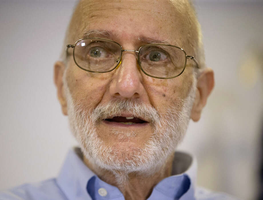 FILE - In this Dec. 17, 2014 file photo, Alan Gross speaking during a news conference at his lawyer's office in Washington. Gross, who returned home last month after spending five years imprisoned in Cuba, will have a prime viewing spot for President Barack Obama's State of the Union address: a seat near first lady Michelle Obama. (AP Photo/Pablo Martinez Monsivais)