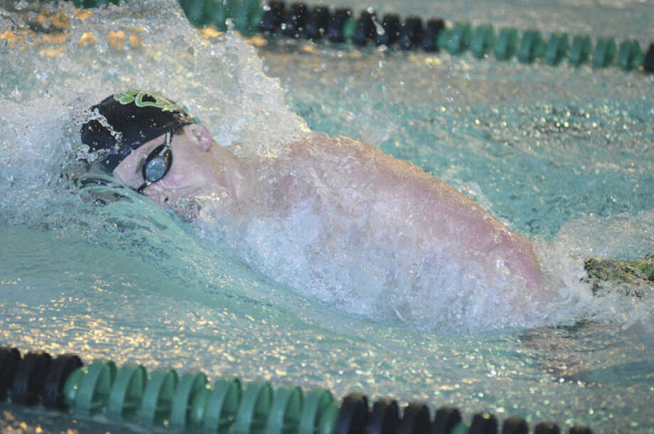Hour photo/Alex von KleydorffNorwalk-McMahon junior captain Anthony Dell'Isola swims to victory in the 500 freestyle event at Friday's meet against Wilton at the Par Spinola Natatorium. Dell'Isola also won the 200 free, but Wilton used its depth to take a 97-73 win over the co-op.