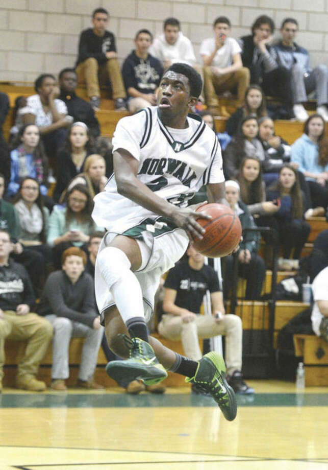 Norwalk's ZaireWilson flies toward the hoop during Friday night's game against New Canaan. Wilson and the Bears saddled the visiting Rams with a 49-36 defeat.Hour Photo/Alex von Kleydorff