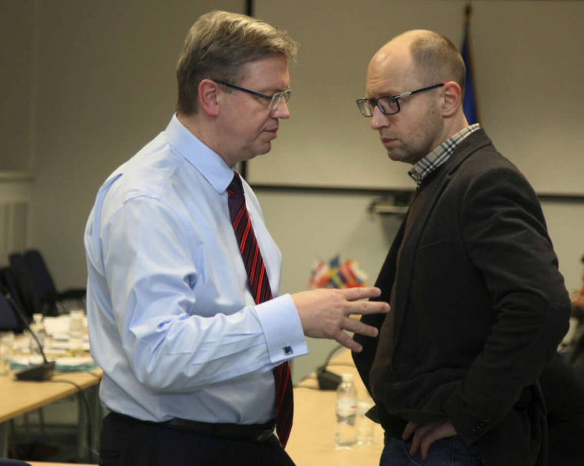 European Commissioner for Enlargement and European Neighborhood Policy Stefan Fule, left, and Ukrainian opposition leader Arseniy Yatsenyuk talk during a meeting in Kiev, Ukraine, Friday, Jan. 24, 2014. (AP Photo/Anatolii Stepanov, Pool)