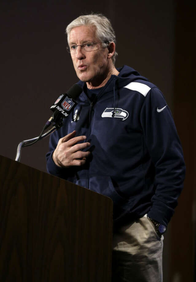 Seattle Seahawks head coach Pete Carroll answers a question during a news conference Monday, Jan. 27, 2014, in Jersey City, N.J. The Seahawks and the Denver Broncos are scheduled to play in the Super Bowl XLVIII football game Sunday, Feb. 2, 2014. (AP Photo/Jeff Roberson)