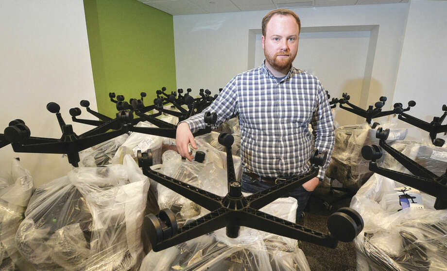 Hour Photo/Alex von Kleydorff Austin McChord, CEO and Founder of Datto stands in a room filled with brand new office chairs ready to be unwrapped and placed in a new space his company expanding to and is re fitting at 101 Merritt View in Norwalk