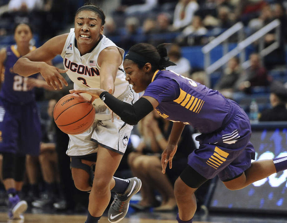 Connecticut's Morgan Tuck reaches for the ball against East Carolina's Janesha Ebron, right, during the first half of an NCAA college basketball game, Wednesday, Jan. 28, 2015, in Hartford, Conn. (AP Photo/Jessica Hill)