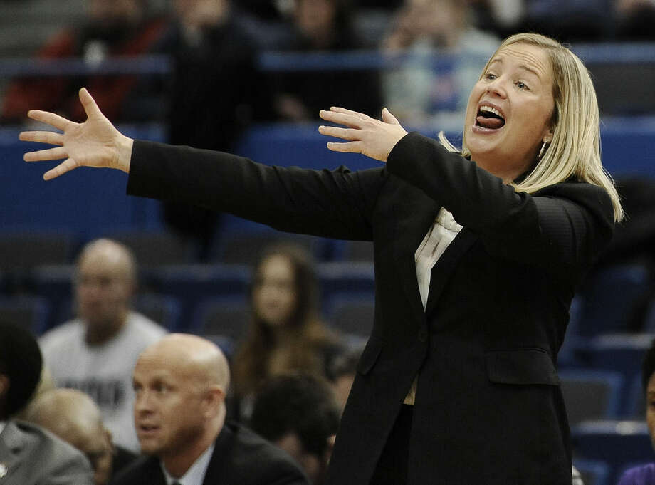 East Carolina head coach Heather Macy calls out to her team during the first half of an NCAA college basketball game against UConn Wednesday, Jan. 28, 2015, in Hartford, Conn. (AP Photo/Jessica Hill)