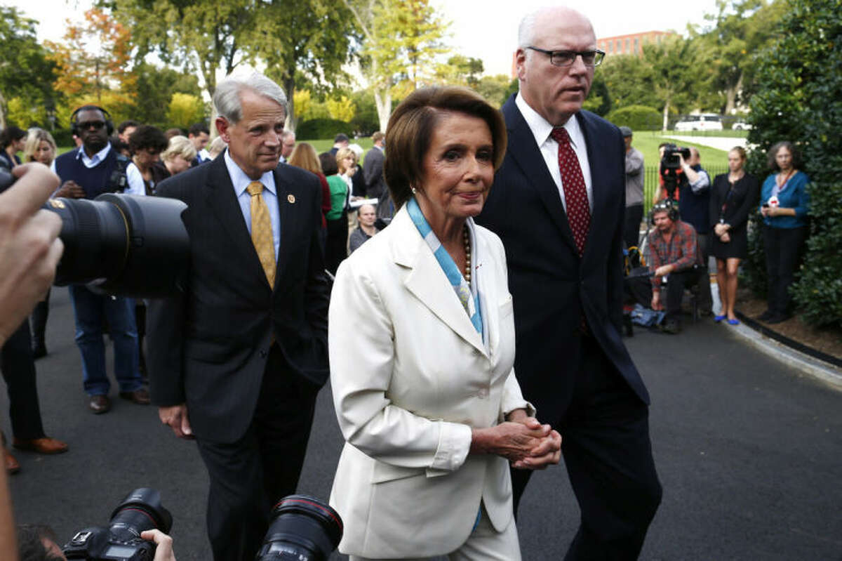 FILE - In this Oct. 15, 2013, file photo, House Minority Leader Nancy Pelosi of Calif., center, walks away after answering questions from reporters with Rep. Steve Israel, D-N.Y., and Rep. Joseph Crowley, D-N.Y., right, after their meeting with President Barack Obama regarding the partial government shutdown and looming debt default outside the West Wing at the White House in Washington. When Obama delivers his State of the Union address on Jan. 28, 2014, he isn?'t just setting out his own agenda. He?'s also delivering an opening salvo in the yearlong fight for control of Congress. Although not explicitly political, the speech will frame an economic argument that Democrats hope will appeal to voters across the country.