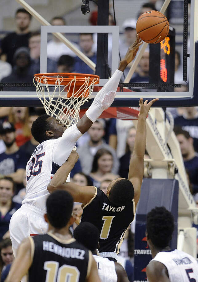 Connecticut's Amida Brimah (35) blocks a shot attempt by UCF's B.J. Taylor (1) during the second half of an NCAA college basketball game, Thursday, Jan. 22, 2015, in Storrs, Conn. Connecticut won 67-60. (AP Photo/Jessica Hill)