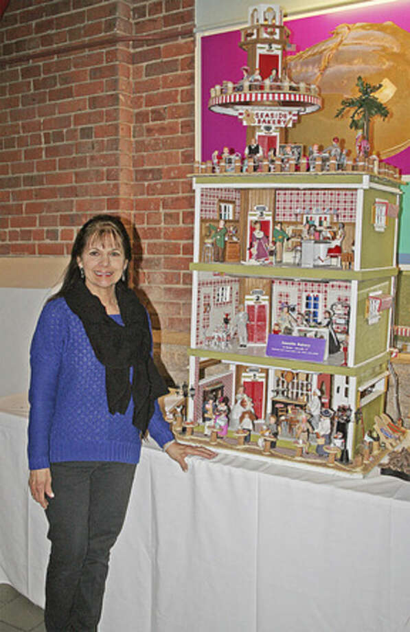"""Contributed photoJo Stecker of Norwalk stands with her fifth-place winner, """"Seaside Bakery,"""" in The Maritime Aquarium at Norwalk's 13th annual """"Festival of Lighthouses Contest."""""""