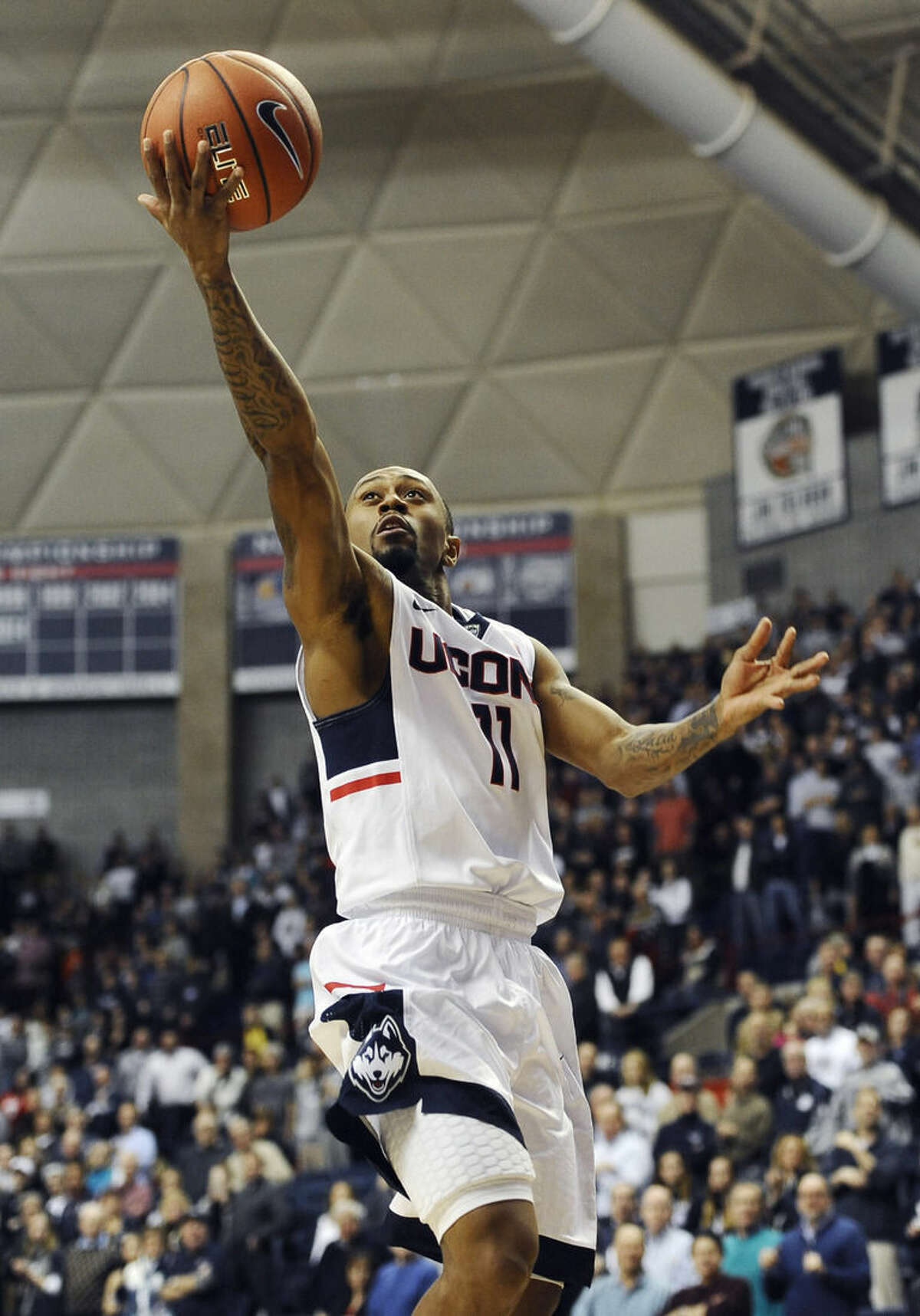 Connecticut's Ryan Boatright goes up for a shot during the first half of an NCAA college basketball game against UCF, Thursday, Jan. 22, 2015, in Storrs, Conn. (AP Photo/Jessica Hill)