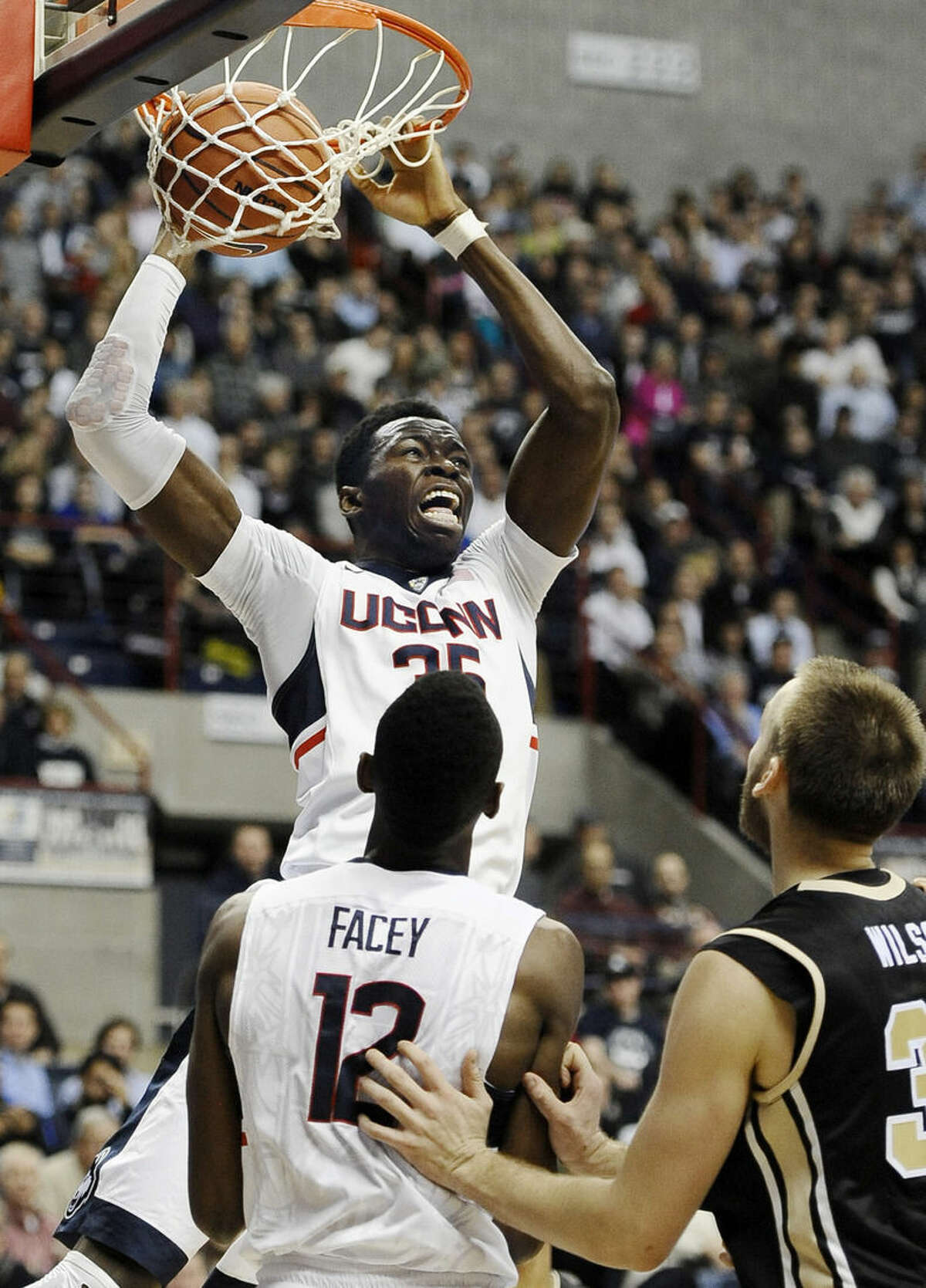 Connecticut's Amida Brimah dunks during the second half of an NCAA college basketball game against UCF, Thursday, Jan. 22, 2015, in Storrs, Conn. Connecticut won 67-60. (AP Photo/Jessica Hill)