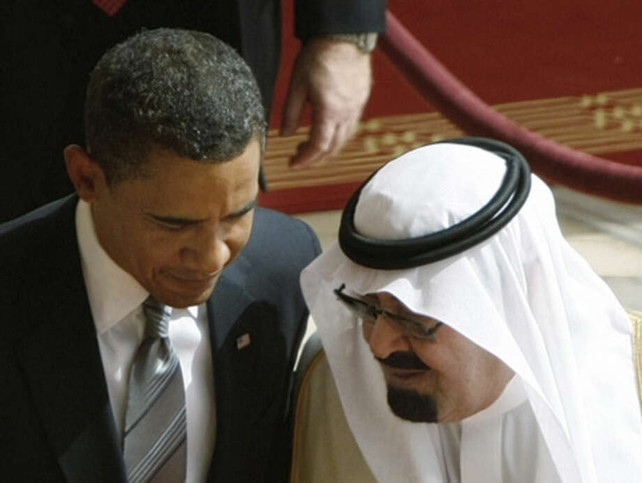 FILE - In this Wednesday, June 3, 2009 file photo, King Abdullah of Saudi Arabia, right, speaks with U.S. President Barack Obama, during arrival ceremonies at the Royal Terminal of King Khalid International Airport in Riyadh, Saudi Arabia. On early Friday, Jan. 23, 2015, Saudi state TV reported King Abdullah died at the age of 90. (AP Photo/Hassan Ammar)