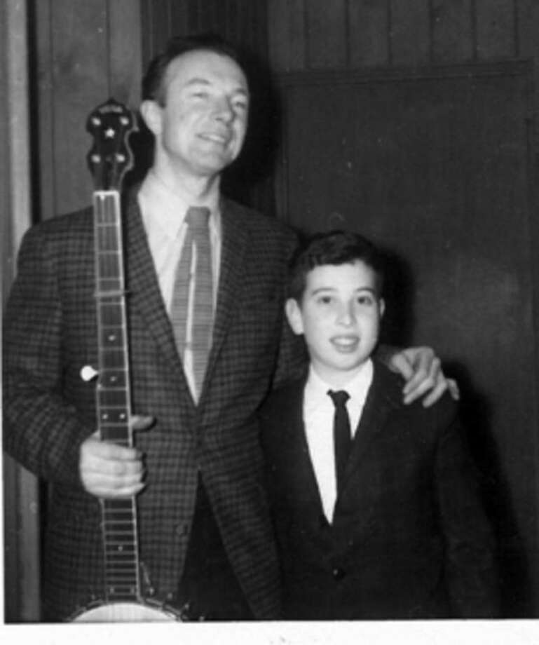 Contributed by Alex KnoppFolk singer Pete Seeger stands with an 11-year old Alex Knopp in Norwalk in 1958.