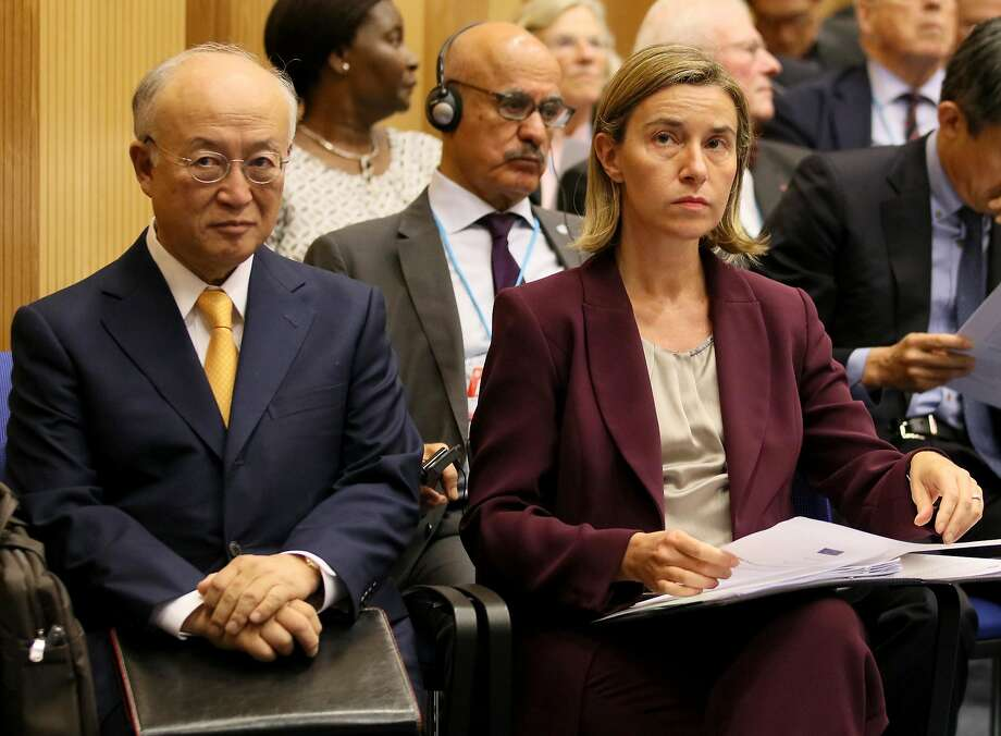 Director General of the International Atomic Energy Agency Yukiya Amano (left) and EU foreign policy chief Federica Mogherini meet in Vienna. Photo: Ronald Zak, Associated Press