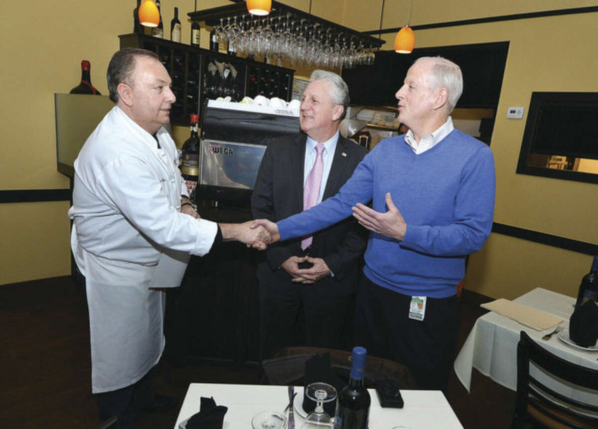 Hour Photo/Alex von Kleydorff Mikes Ristorante owner Nino Pagliarulo is awawrded a top restaurant Lighththouse rating award by Mayor Harry Rilling and Director of Health Timothy J. Callahan.
