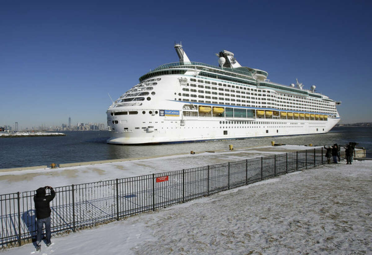 The Explorer of the Seas cruise ship backs into a berth as it arrives, Wednesday, Jan. 29, 2014, in Bayonne, N.J. The number of passengers and crew reported stricken ill on the cruise ship has risen to nearly 700. The U.S. Centers for Disease Control and Prevention said Wednesday its latest count puts the number of those sickened aboard the Explorer of the Seas at 630 passengers and 54 crew members. (AP Photo/Mel Evans)