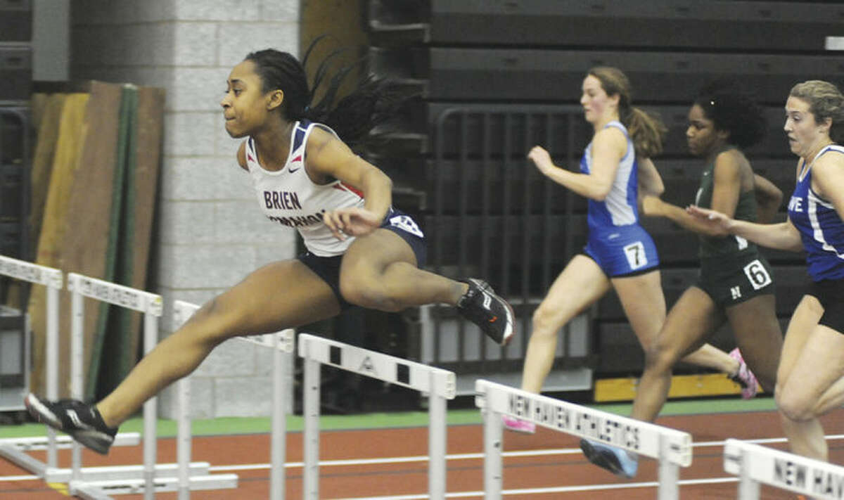 Hour photo/John Nash Sarah Boyd of Brien McMahon easily leads the field as she races to victory in the 55-meter hurdles at Wednesday's FCIAC track championship at the Floyd Little Athletic Center in New Haven. Boyd also finished second in the long jump.