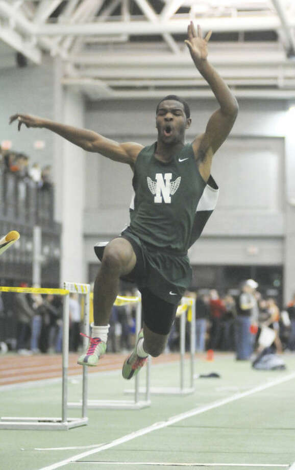 Hour photo/John NashLester Harris of Norwalk competes in the boys long jump final at the FCIAC indoor track championship on Wednesday at the Floyd Little Athletic Center in New Haven.