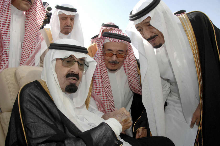 FILE - In this Monday, Nov. 22, 2010 file photo released by the Saudi Press Agency, Saudi Arabia's King Abdullah, left, speaks with Prince Salman, the Saudi King's brother and Riyadh governor, right, before the king's departure to United States, in Riyadh, Saudi Arabia. On early Friday, Jan. 23, 2015, Saudi state TV reported King Abdullah died at the age of 90. (AP Photo/Saudi Press Agency, File)