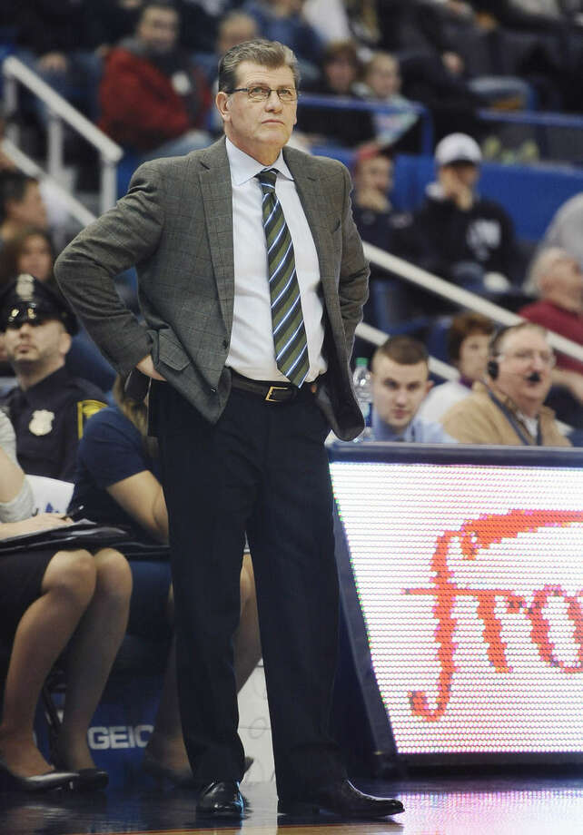 In this Wednesday, Jan. 28, 2015, photo, UConn women's basketball head coach Geno Auriemma stands on the court during the second half of an NCAA college basketball game against East Carolina in Hartford, Conn. Auriemma can record his 900th career win on Tuesday when his second-ranked Huskies host Cincinnati. (AP Photo/Jessica Hill)
