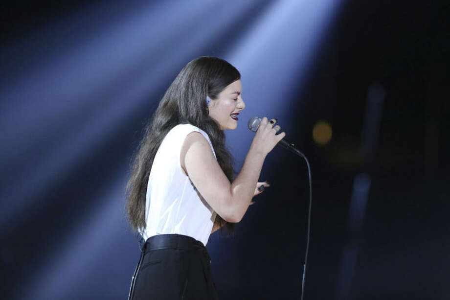 """Lorde performs """"Royals"""" at the 56th annual Grammy Awards at Staples Center on Sunday, Jan. 26, 2014, in Los Angeles. (Photo by Matt Sayles/Invision/AP)"""