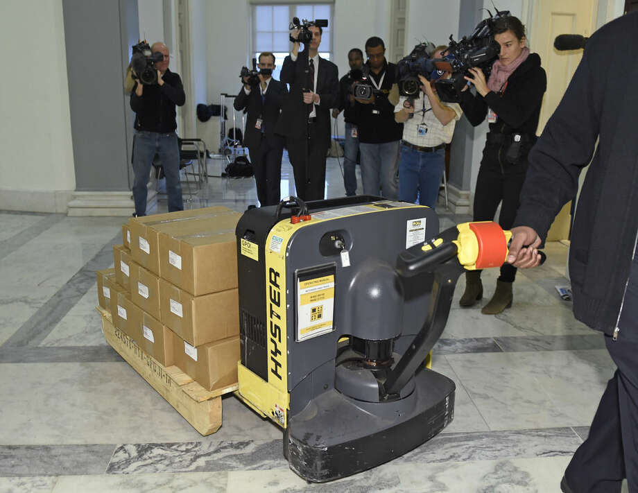 Warren McCray, of Lusby, Md., delivers President Barack Obama's 2015 $4 trillion budget to the House Budget Committee office on Capitol Hill in Washington, Monday, Feb. 2, 2015. (AP Photo/Susan Walsh)