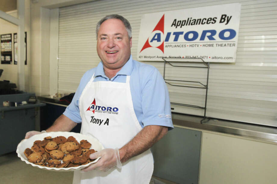 Hour photo/Chris Palermo Tony Aitoro of Aitoro Appliance hands out cookies at Chilifest at Bedford Middle School Sunday.