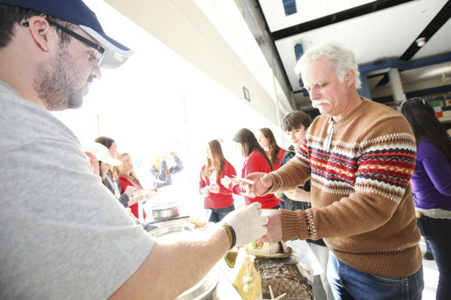 Hour photo/Chris Palermo Folks enjoy the chili at Chilifest at Bedford Middle School Sunday.