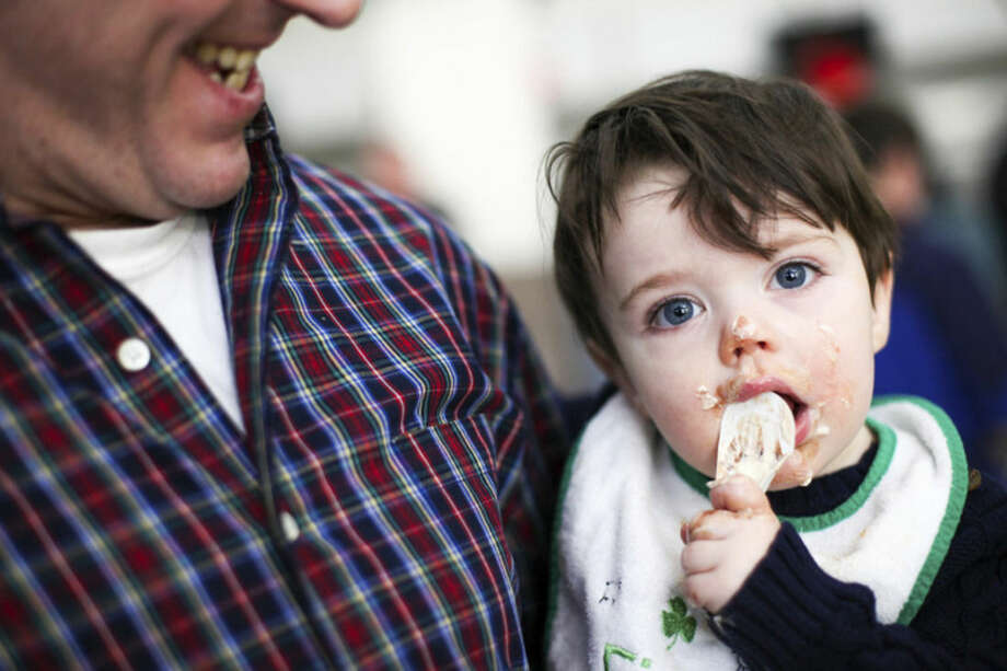 Hour photo/Chris Palermo Finnian Flemma, 1, of Trumbull really enjoys tiramisu at Chilifest at Bedford Middle School Sunday.