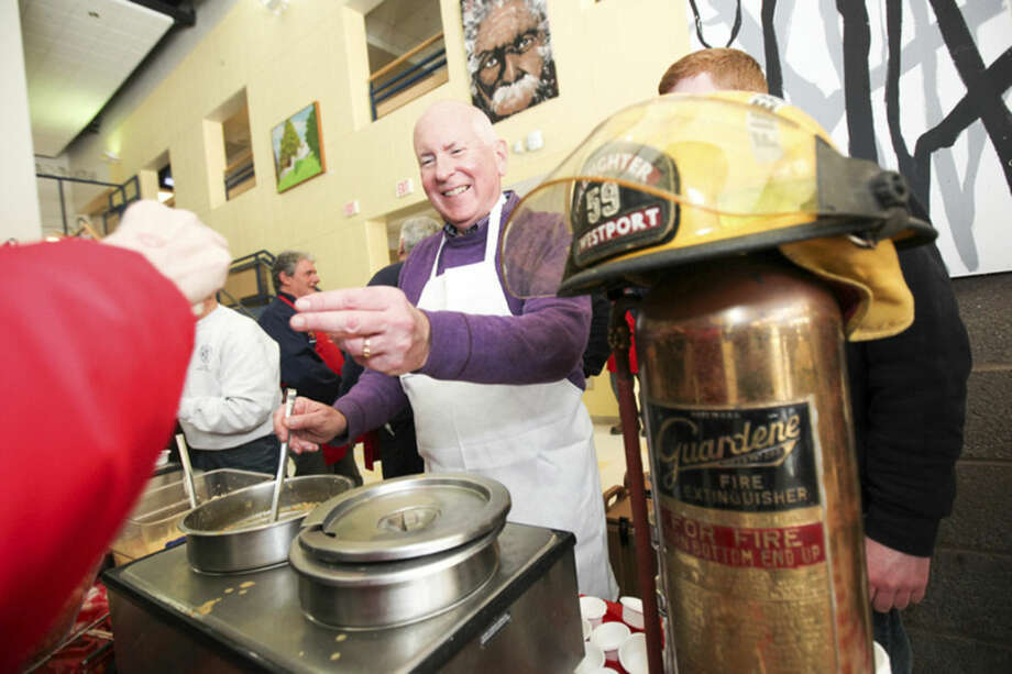 Hour photo/Chris PalermoWestport Selectman Jim Marpe hands out chicken chili at the Westport Fire Department's booth at Chilifest at Bedford Middle School Sunday.