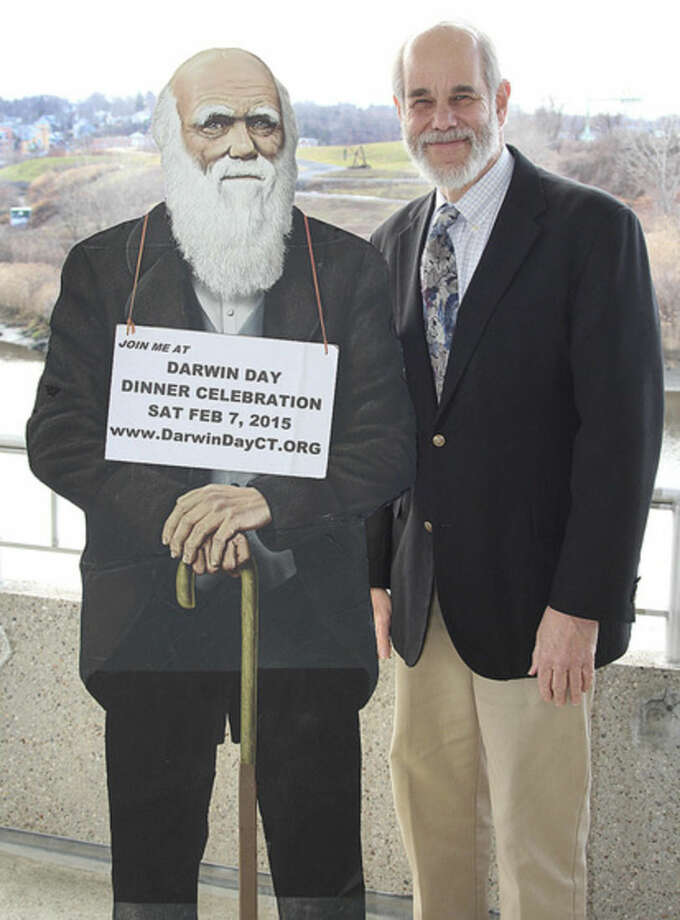 Hour photo/Chris BosakCary Shaw, one of the organizers of the upcoming Darwin Day Dinner Celebration, stands next to a life-sized cutout of Charles Darwin.