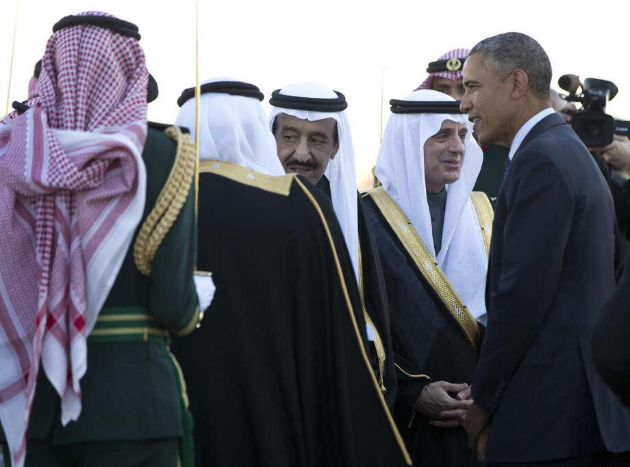 AP Photo/Carolyn KasterPresident Barack Obama is greeted by new Saudi King Salman bin Abdul Aziz as the president and first lady Michelle Obama arrive on Air Force One at King Khalid International Airport, in Riyadh, Saudi Arabia, Tuesday, Jan. 27.