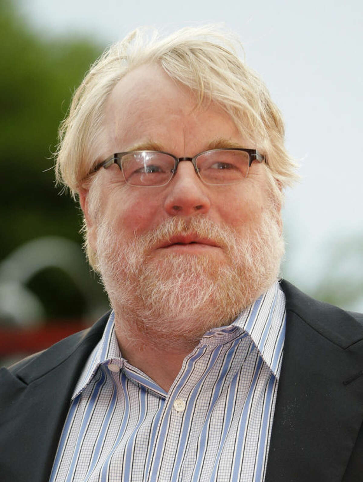 FILE - In this Sept. 1, 2012 file photo, actor Philip Seymour Hoffman arrives for the premiere of 'The Master' at the 69th edition of the Venice Film Festival in Venice, Italy. The death of actor Philip Seymour Hoffman has once again drawn attention to a New York City heroin trade so sophisticated that getting the drug delivered to your door is nearly as easy as ordering a pizza. (AP Photo/Andrew Medichini, File)