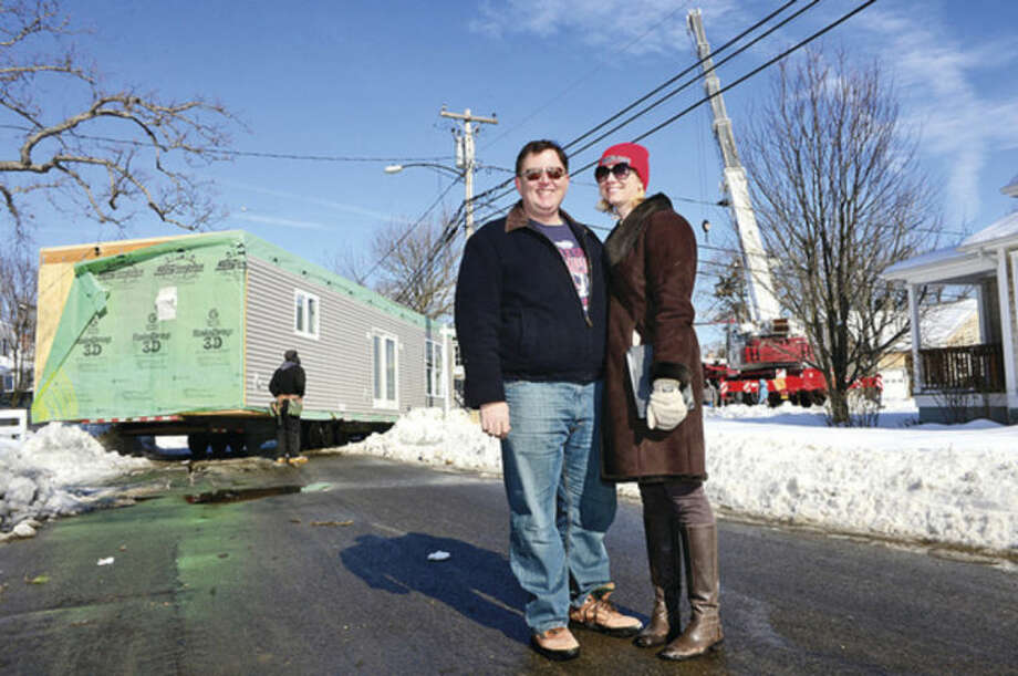 Hour photo / Erik Trautmann 466 days after Superstorm Sandy destroyed their home, Harborview residents Ron Kowalski and his wife Shauna Lagatol have their new modular home put on its foundation at 3 Oliver St Thursday.