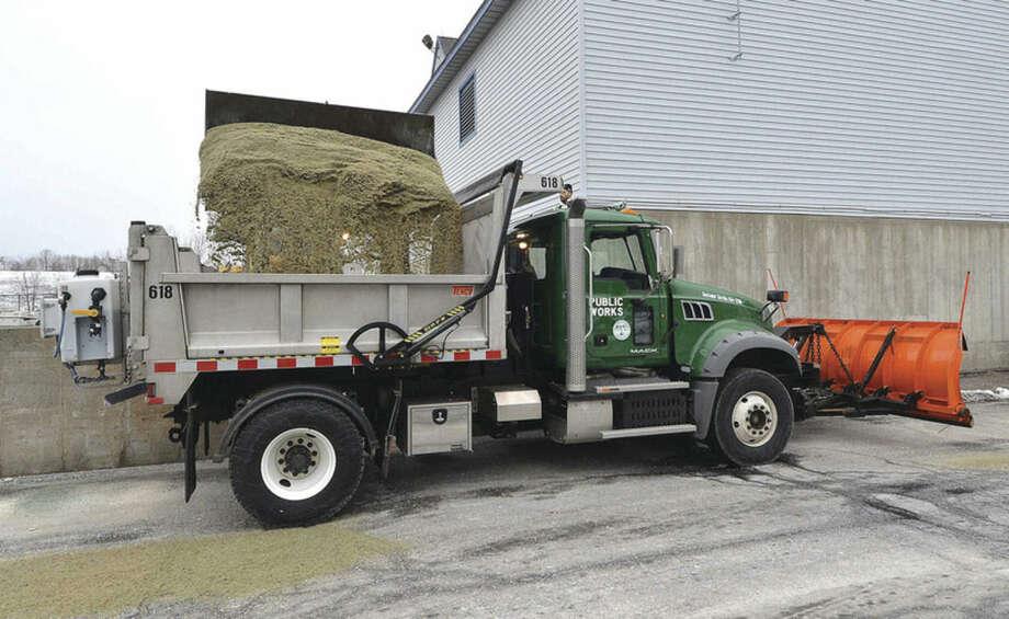Hour Photo/Alex von Kleydorff Salt mixture is loaded for spreading on Norwalk's roads