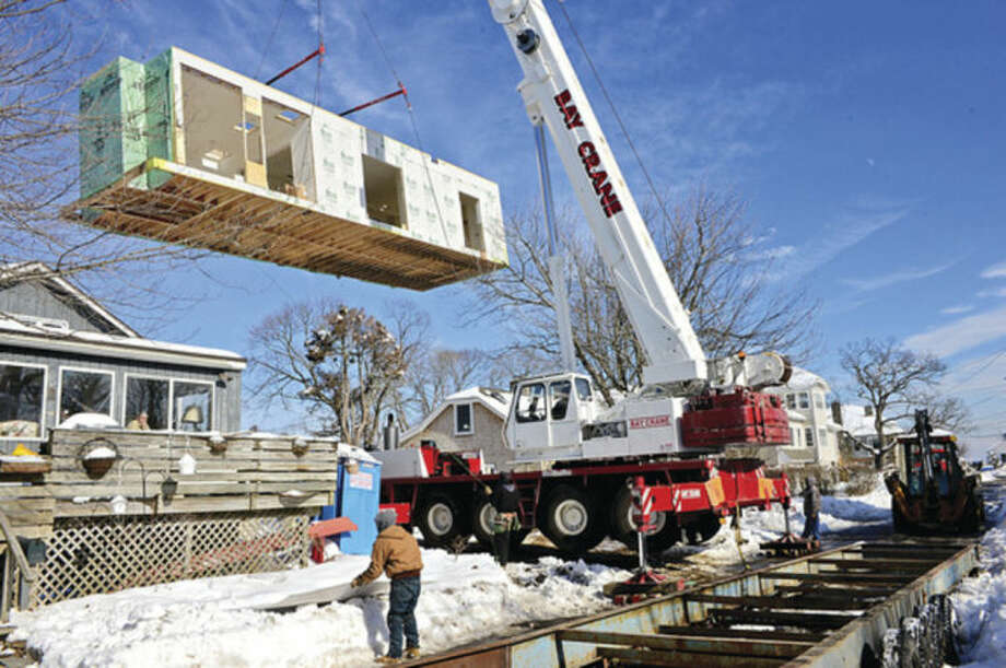 Hour photo / Erik Trautmann466 days after Superstorm Sandy destroyed their home, Harborview residents Ron Kowalski and his wife Shauna Lagatol have their new modular home put on its foundation at 3 Oliver St. Thursday.