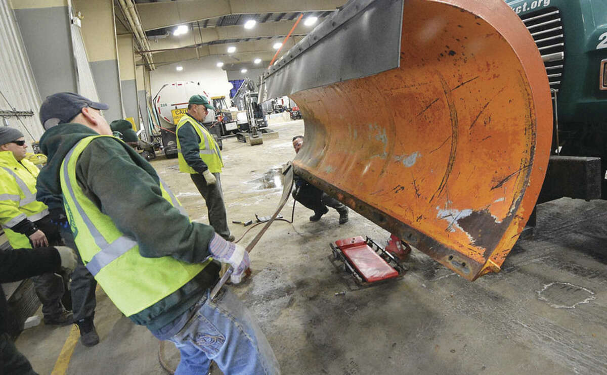 Hour Photo/Alex von Kleydorff Off with the old plow blade, ready for installing a new one on one of the city's snow plows during preparation at the Public Works garage on Monday morning