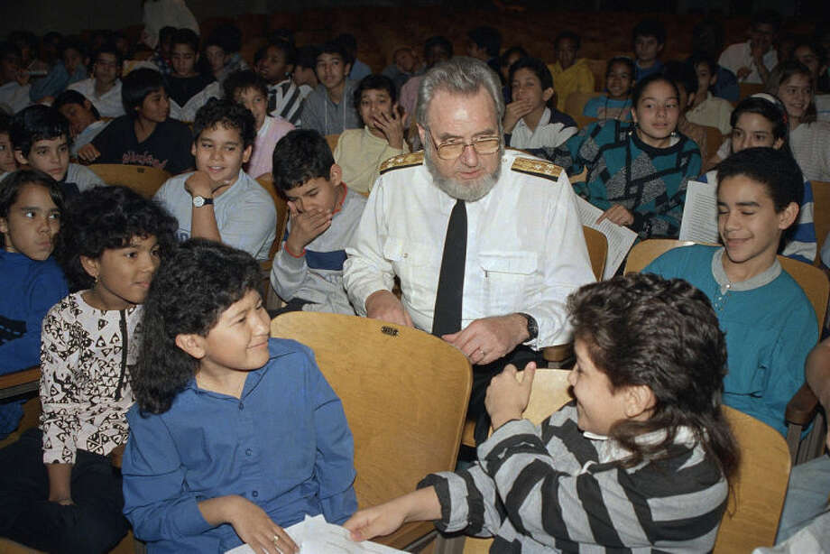 "FILE - In this Monday, Nov. 30, 1987 file photo, U.S. Surgeon General C. Everett Koop sits with elementary school students at P.S. III in the Manhattan borough of New York to warn them of the dangers of smoking. In 1984, Koop called for a ""smoke-free society"" by the year 2000. (AP Photo/Richard Drew)"