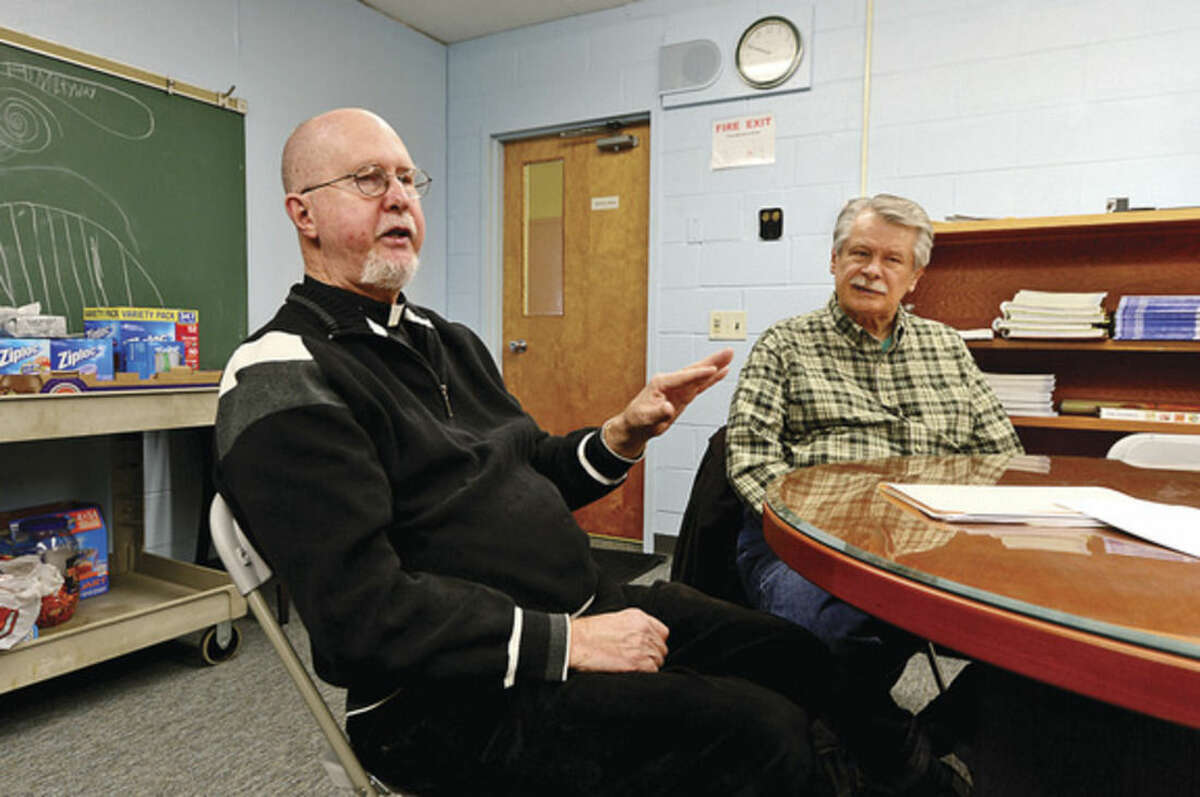 Hour photo / Erik Trautmann Rev. David Blanchfield, pastor of St. Jerome Church, with the help of Dan Loch, head of the Pastoral Council, has led the church's mission to offer individual works of charity and most recently advocated for the national issue of gun safety.
