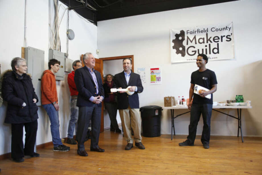 Mayor Harry Rilling and Sen. Bob Duff speak during The Fairfield County Makers' Guild's opening in Norwalk Saturday morning.