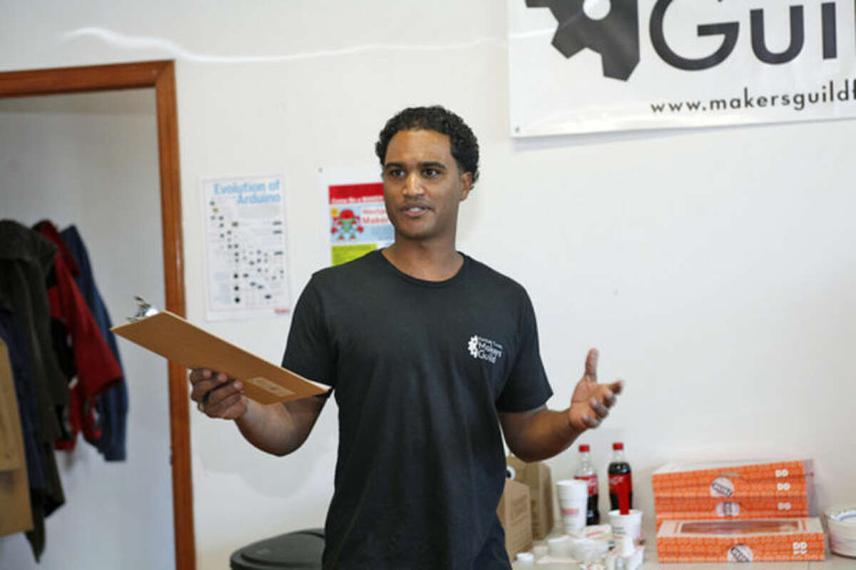 Vladimir Mariano from The Fairfield County Makers' Guild speaks during the Guild's opening in Norwalk Saturday morning.