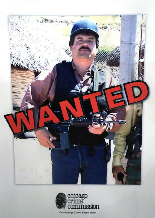 FILE - In a Thursday, Feb. 14, 2013, file photo, a poster displayed at a Chicago Crime Commission news conference in Chicago, shows Joaquin ``El Chapo'' Guzman, who was deemed Chicago's Public Enemy No. 1. A senior U.S. law enforcement official said Saturday, Feb. 22, 2014 that Guzman, the head of Mexico's Sinaloa Cartel, was captured alive overnight in the beach resort town of Mazatlan, Mexico. Guzman faces multiple federal drug trafficking indictments in the U.S. and is on the Drug Enforcement Administration?s most-wanted list. His cartel has been heavily involved in the bloody drug war that has torn through parts of Mexico for the last several years.  (AP Photo/M. Spencer Green, File)