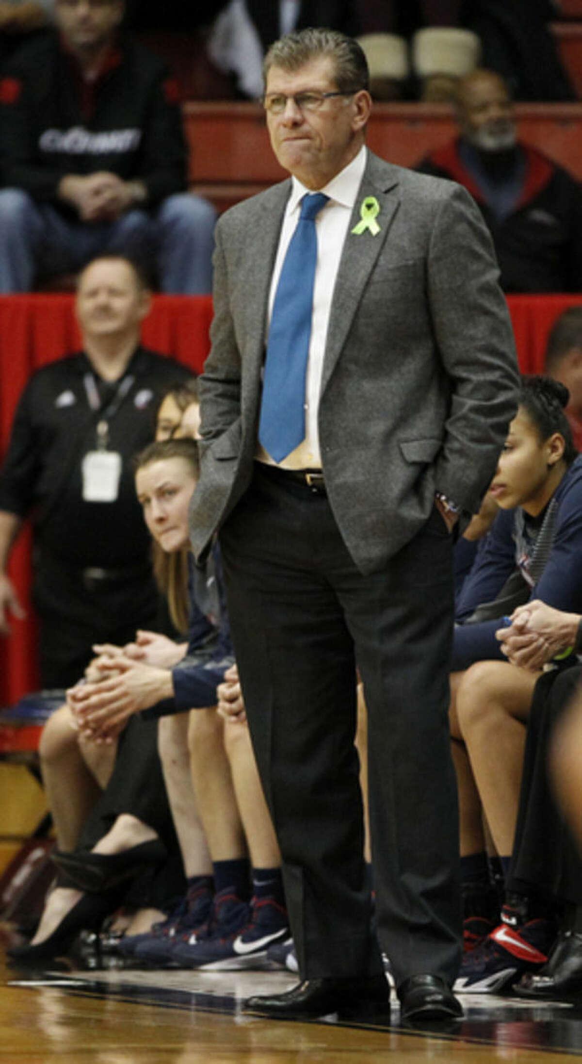 Connecticut head coach Geno Auriemma watches his team against Cincinnati during the first half of their NCAA college basketball game, Sunday Jan. 25, 2015 in Cincinnati. (AP Photo/Gary Landers)