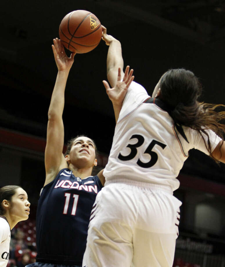 Cincinnati forward Marley Hill (35) blocks a shot by Connecticut guard Kia Nurse (11) during the first half of their NCAA college basketball game, Sunday Jan. 25, 2015 in Cincinnati. (AP Photo/Gary Landers)