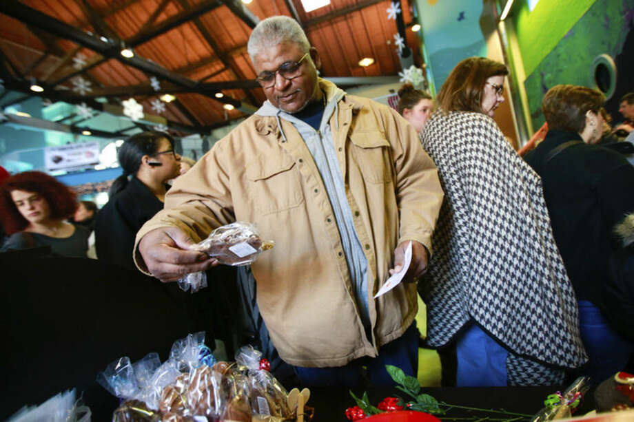 Hour photo/Chris PalermoGonz Ianham checks out some chocolate offered by the Chocolate Rain Shop at the annual Chocolate Expo at the Maritime Aquarium in Norwalk Sunday.