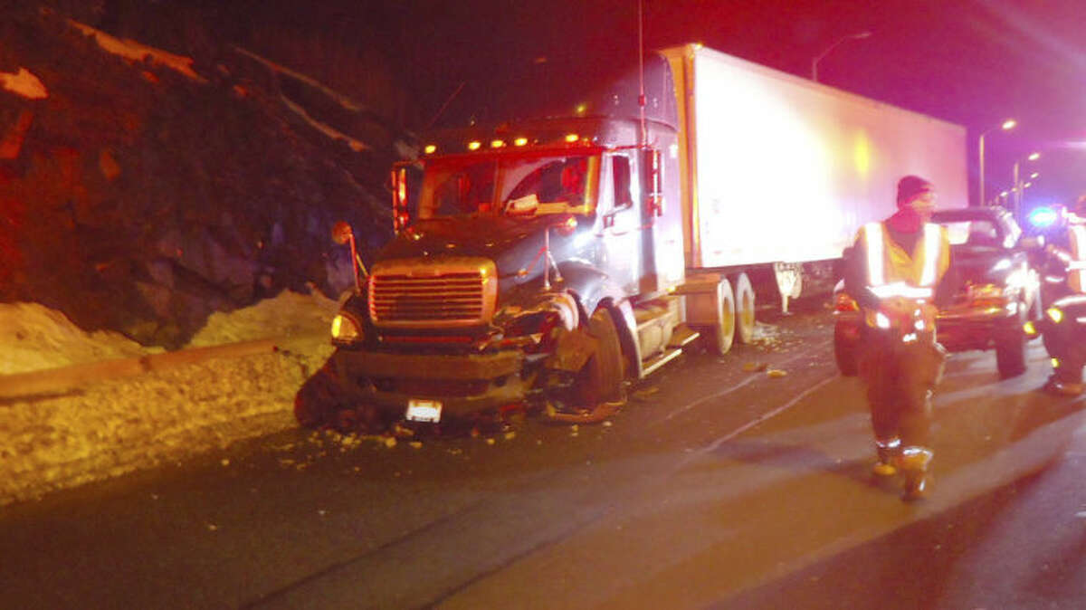 Submitted photo The scene of an early morning accident on I-95 north in Norwalk. Norwalk Fire Department respond around 2 a.m. to the accident involving two cars, one truck and one trackor trailer.